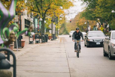 A bike rider riding through the streets of Edina, Minnesota