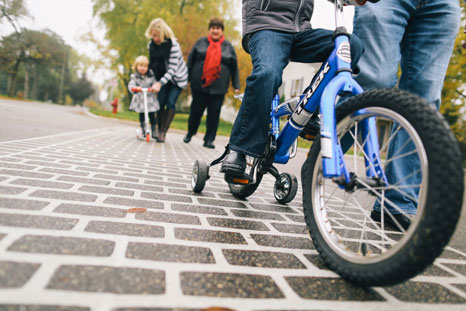A family enjoys a bike ride through their community of Edina.