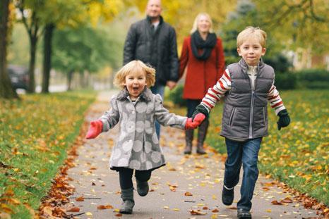 A family enjoying a walk through their neighborhood.