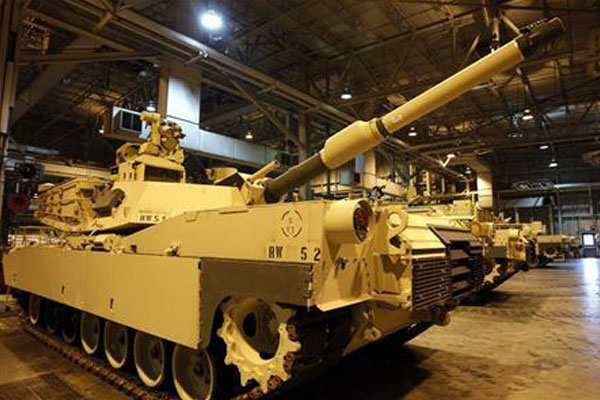 Heavy combat vehicle on production line.