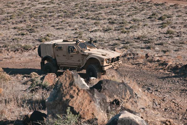 A military vehicle manufactured by the Oshkosh Corporation in action