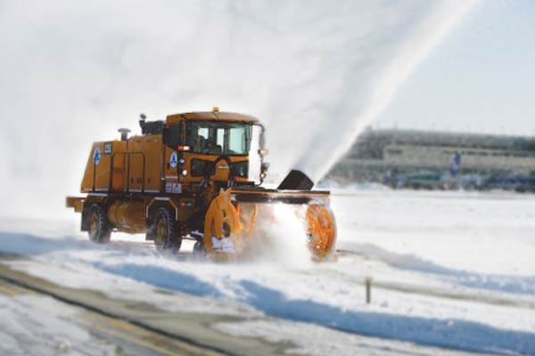 A snow plow clearing the way