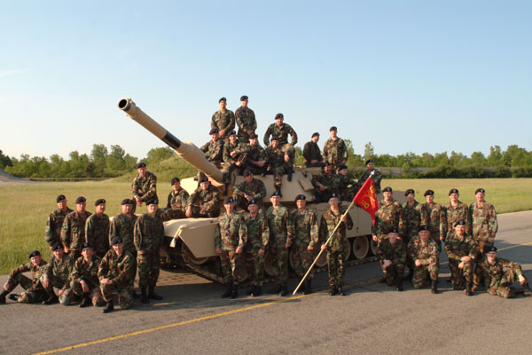 A tank platoon with their M1-A1 Abram tank.