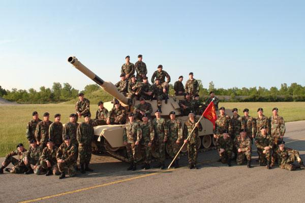 A tank platoon with their M1-A1 Abram tank.